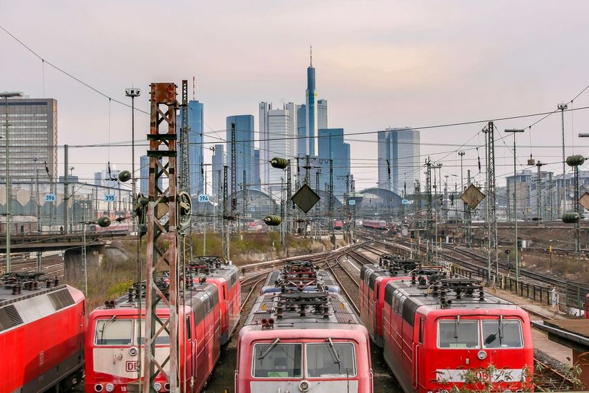 Skyline Train Frankfurt Am Main Frankfurt Sky Transportation Built Structure Architecture Building Exterior Mode Of Transportation City No People Nature Land Vehicle Outdoors Connection Industry Communication Technology Cloud - Sky Motor Vehicle Machinery Building
