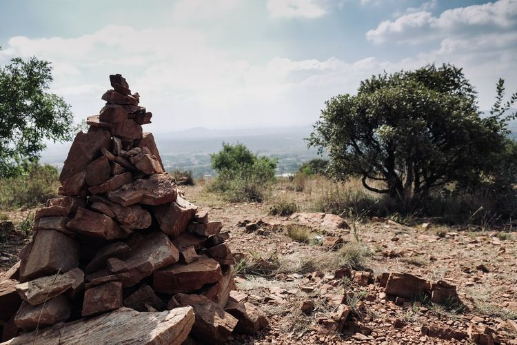 View of rocks on land against sky