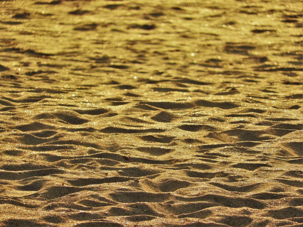 Full Frame Shot Of Sand On Sunny Day