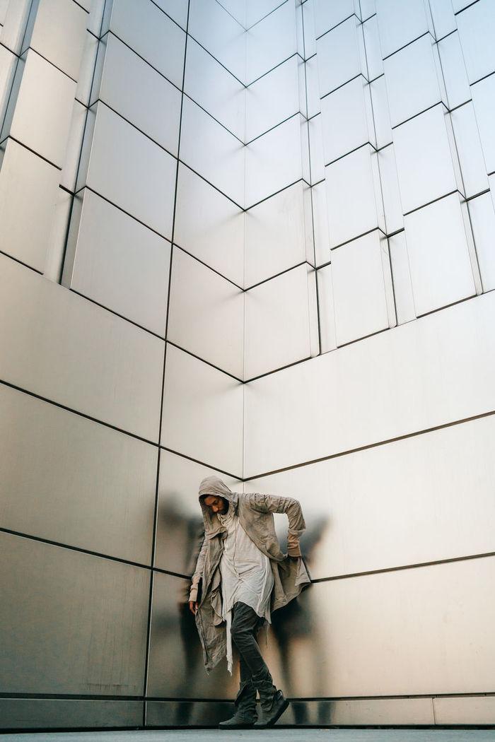 PEOPLE WALKING ON BUILDING WALL