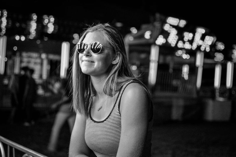 Portrait of young woman in sunglasses