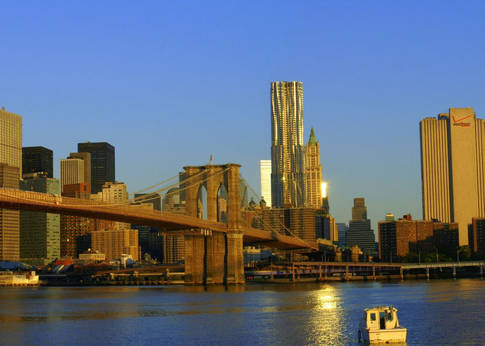 Alba a New York Architecture Boat Bridge - Man Made Structure Broklyn Bridge Built Structure City New York NYC Orange Color Tramonto A Nyc Travel Destinations Urban Skyline Water