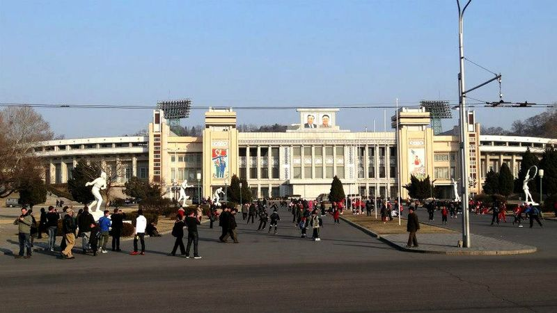 Architecture Building Exterior Built Structure City City Life Destination DPRK Group Of People Incidental People Large Group Of People Lifestyles Men North Korea People In The Background Real People Residential District Street Streetphotography Tourism Travel Urban Walking Women EyeEm Best Shots
