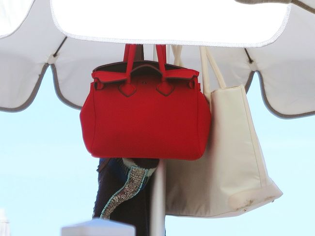 At The Beach Bag Bags Beach Close-up Day Detail Fashion Handbag  Handbags Hanging Life Is A Beach Lifestyle Lifestyles No People Outdoors Parasol Privacy Red Red Bag Sky Still Life Women
