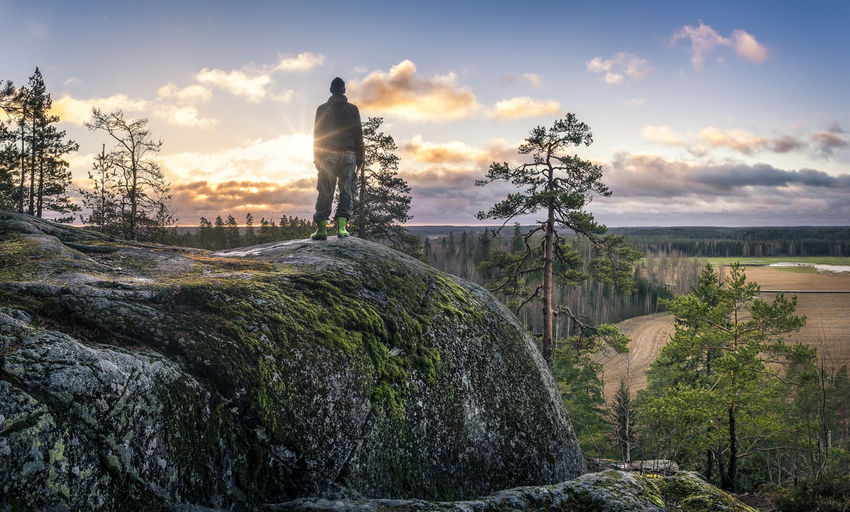 One man hiking at scenic landscape in southern Finland. Adult Beauty In Nature Blue Sky Hiking Horizon Over Land Landscape Light Morning Moss Nature One Man Only One Person Outdoors People Pine Rocky Scenics Standing Stony Sunbeam Sunlight Sunrise Sunset Tree Trees Miles Away