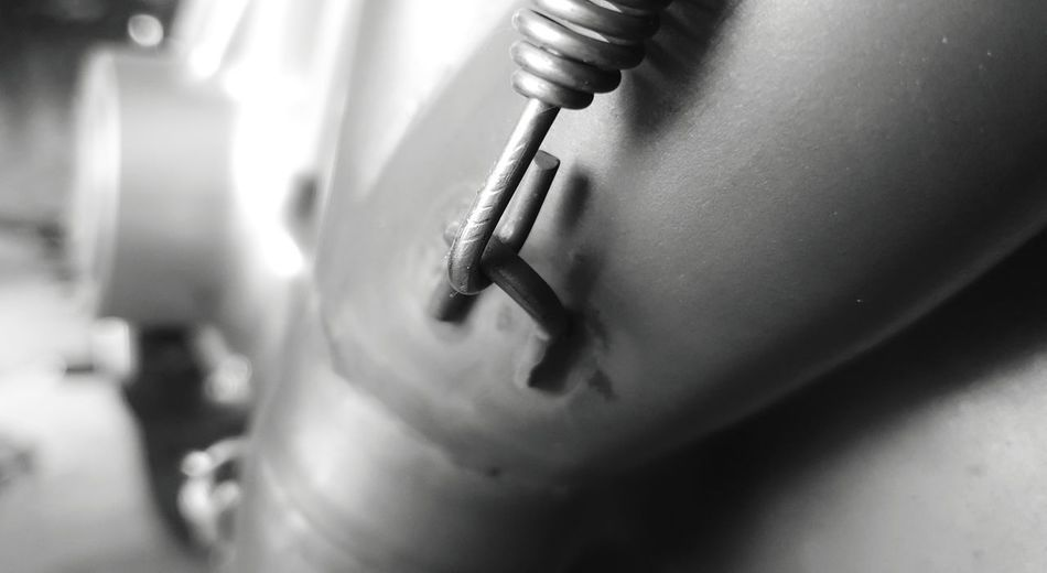 Close-up of human hand on metal chain