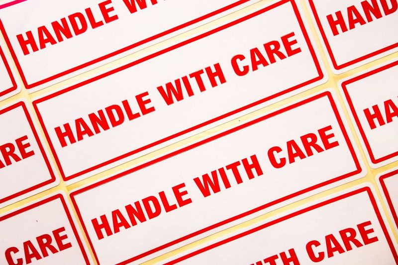 Handle With Care Stickers Breakable  Care Labels Stickers Backgrounds Careful Close-up Fragile Full Frame Indoors  Mailing Message No People Nobody Pattern Red Red Letters Warning
