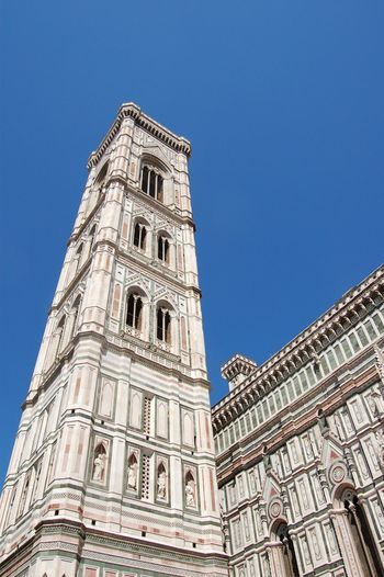 Low angle view of giotto campanile against clear blue sky