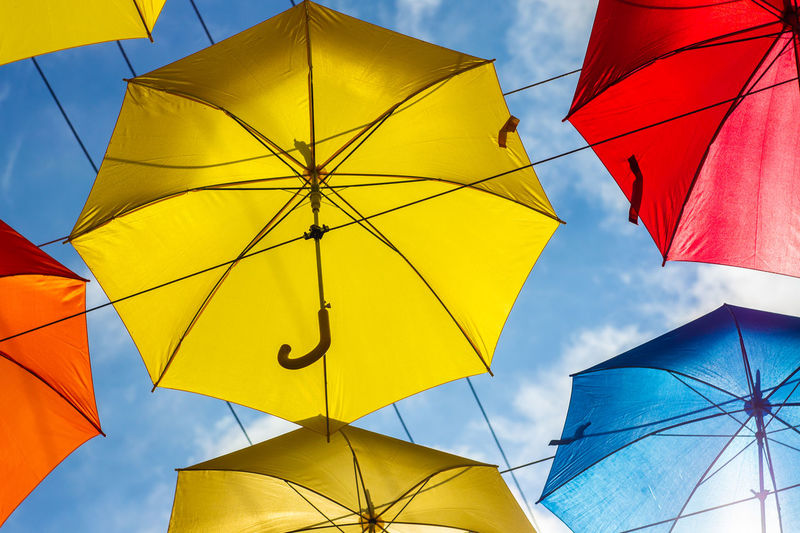 Alley of Soaring Umbrellas. Annual summer festival. Blue Cloud - Sky Day Group Of Objects Low Angle View Multi Colored No People Outdoors Parasol Protection Rain Sheltering Sky Umbrella Yellow