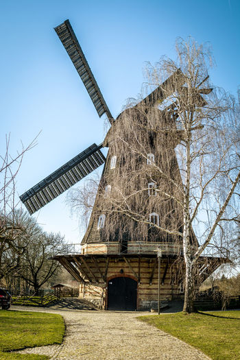 Nature No People Day Outdoors Tree Wind Power Turbine Wind Turbine Architecture Sky Plant Environment Renewable Energy Environmental Conservation Built Structure Traditional Windmill Alternative Energy Bare Tree Fuel And Power Generation Field Landscape