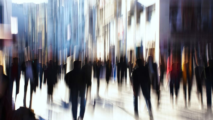 Group of people walking in store