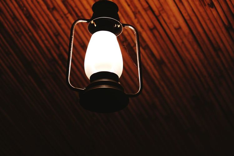 Low angle view of illuminated lantern hanging on ceiling