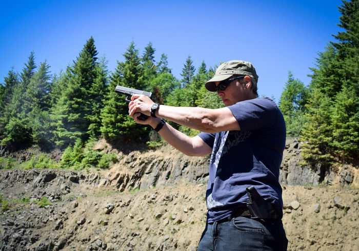 Action Adventure Balance Casual Clothing Composition Day Full Length Getting Away From It All Gun Hanging Out Holding Leisure Activity Lifestyles Oregon Outdoors Perspective Real People Shooting Side View Sport Standing Streamzoofamily THESE Are My Friends Three Quarter Length Law Enforcement