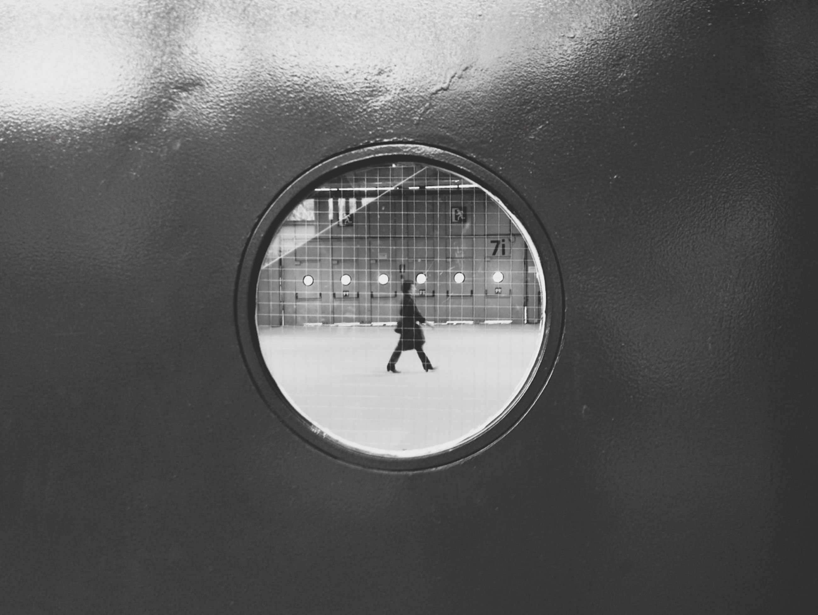 indoors, lifestyles, silhouette, full length, walking, men, leisure activity, reflection, arch, window, architecture, rear view, built structure, standing, glass - material, tunnel, day, boys