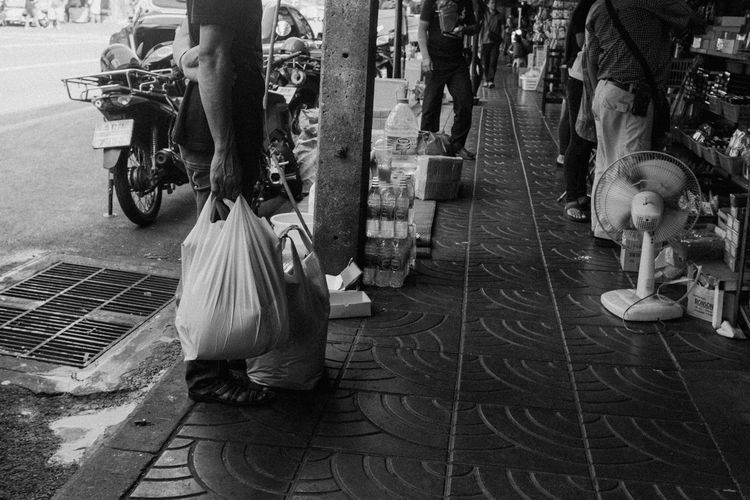 Shopping Spree Day Fujifilm_xseries Low Section Real People Men City Group Of People Transportation Street Walking People Lifestyles Mode Of Transportation Adult Sidewalk City Life Women Sitting Incidental People Medical Equipment Footpath