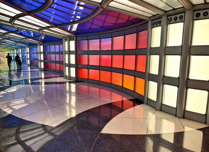 Flooring Architecture Indoors  Tile Corridor Tiled Floor Glass - Material Built Structure Modern Arcade Pattern Lobby Incidental People Ceiling Design Reflection Transportation Building Illuminated Lighting Equipment Entrance Hall Glass