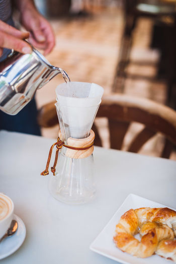 Close-up of barista making coffee in cafe
