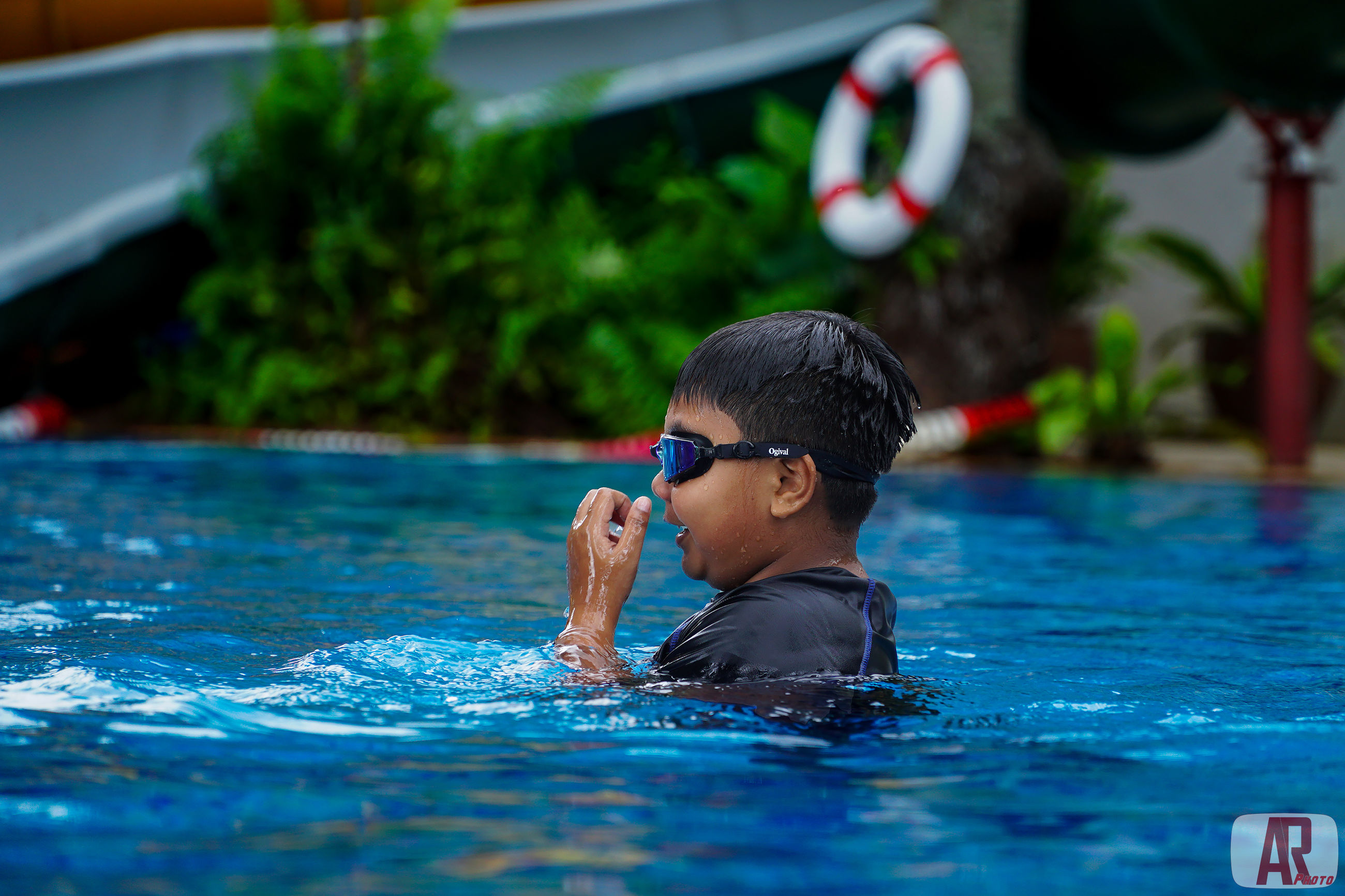 child, childhood, one person, boys, water, real people, males, swimming, swimming pool, pool, men, headshot, lifestyles, portrait, leisure activity, day, innocence, eyewear, outdoors