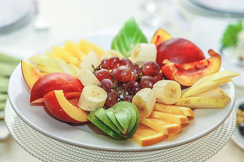 Close-up of fruit salad in plate on table