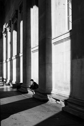 solitude. Streetphotography Streetphoto_bw Street Photography Malephotographerofthemonth LONDON❤ London Street Photo Architectural Column Shadow History Sunlight Architecture Built Structure Colonnade Column The Street Photographer - 2018 EyeEm Awards