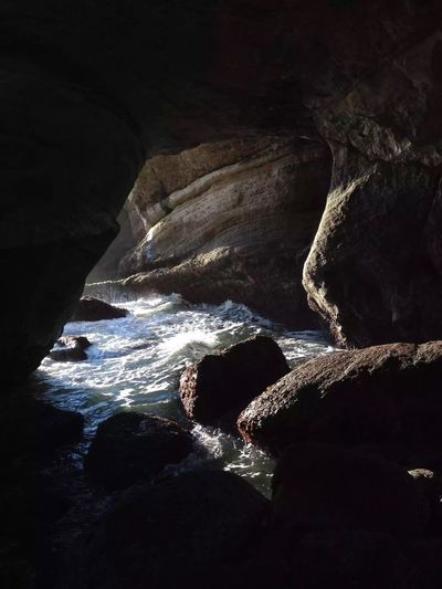 Inside Devil's Punchbowl. Coast Atmosphere EyeEm Exploring Oregon Scenery Water Rock Rock - Object Nature Sea Solid Cave Rock Formation Sunlight Day Beauty In Nature Beach Land Power In Nature Motion Outdoors Tranquility No People