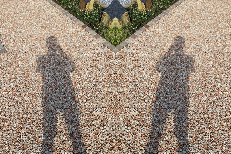 Close-up of a picture with gravel stones, pebbles as a background Real People Shadow High Angle View Men Day Sunlight Nature Lifestyles Focus On Shadow Standing People Adult Unrecognizable Person Road Leisure Activity City Outdoors Plant #NotYourCliche Love Letter