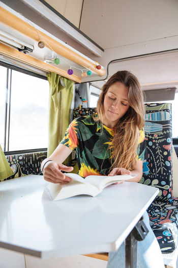 Woman Traveling In Camper Van