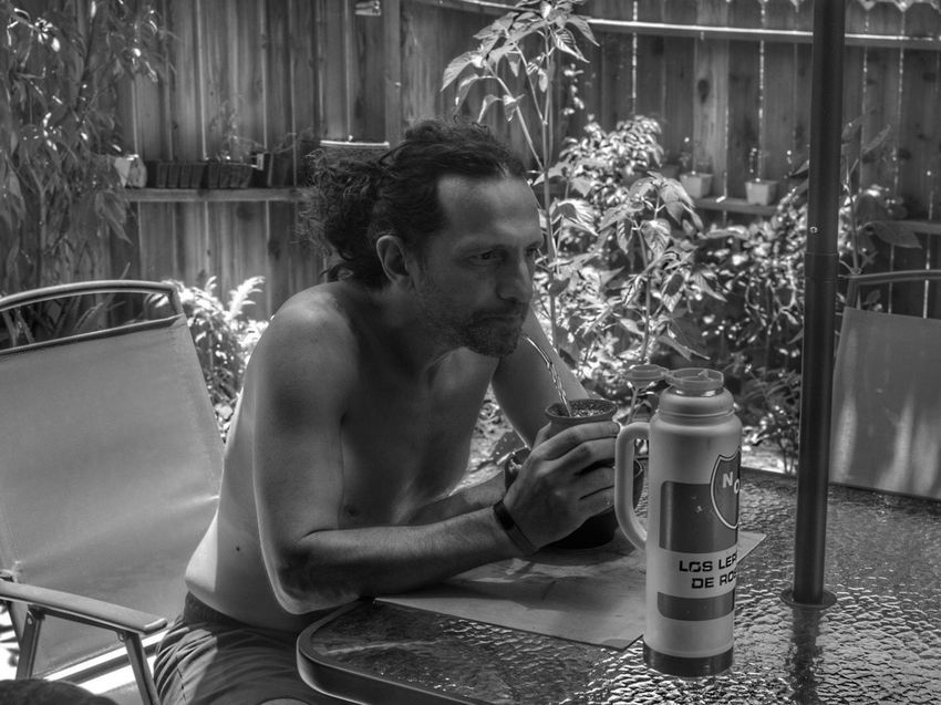 Sitting Holding Lifestyles Leisure Activity Young Adult Vacations Casual Clothing Enjoyment Day Outdoors Freshness Mate Drinking Mate Blackandwhite Yerba Mate Blackandwhite Photography
