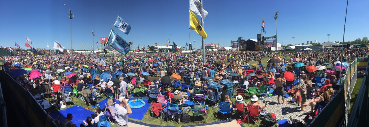 Panorama shot of massive crowd at New Orleans Jazz Festival Jazz Festival Live Music Music Adult Celebration Crowd Enjoyment Fan - Enthusiast Festival Flag Large Group Of People Leisure Activity Lifestyles Live Event Men Music Music Festival Outdoors People Real People Sky Spectator Women