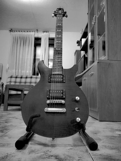 Music Guitar String Instrument Electric Guitar Musical Instrument Day Indoors  People Archival
