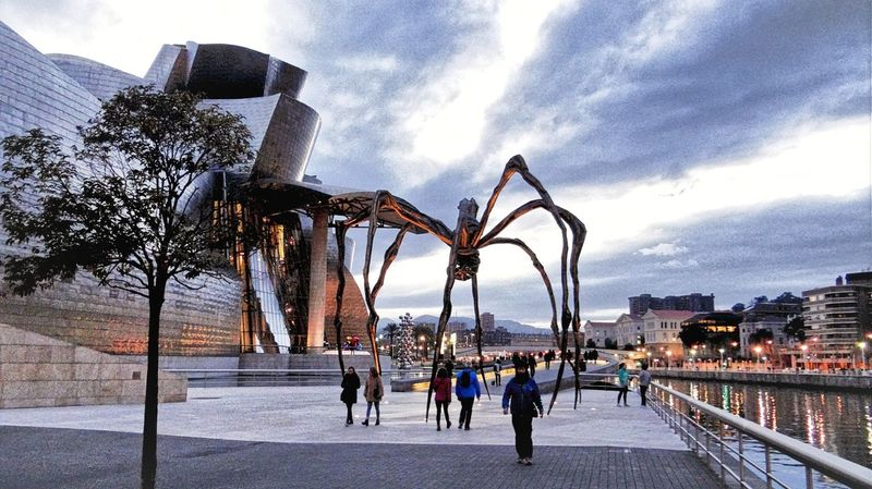 Guggenheim Spider Twilight Street View Showcase March Ladyphotographerofthemonth Basque Country Maman Louise Bourgeois Bronze Sculpture Street Photography Urban Exploration Better Look Twice Here Belongs To Me The Architect - 2016 EyeEm Awards Cities At Night On The Way People And Places