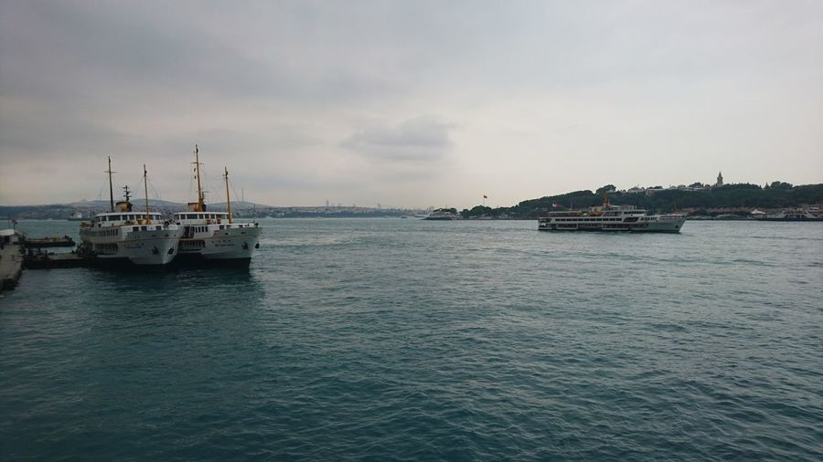 Bosphorus with boats. · Istanbul Turkey Eurasia Bosphorus Boats Water Waterfront From A Bridge Capitals  Capital Cities  Urban Landscape Cityscape Gray Clouds And Sky Clouds And Sky And Water
