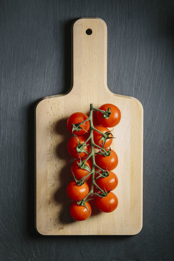 Directly above shot of cherry tomatoes on cutting board