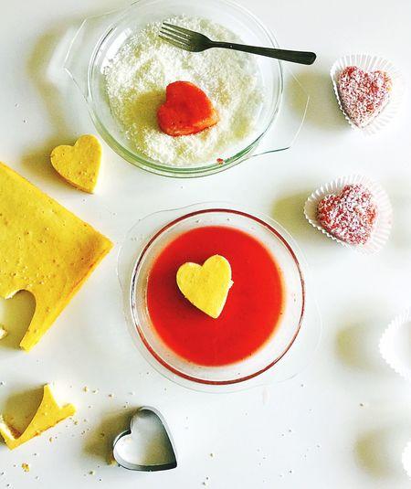 Heart shape cookies being prepared on table