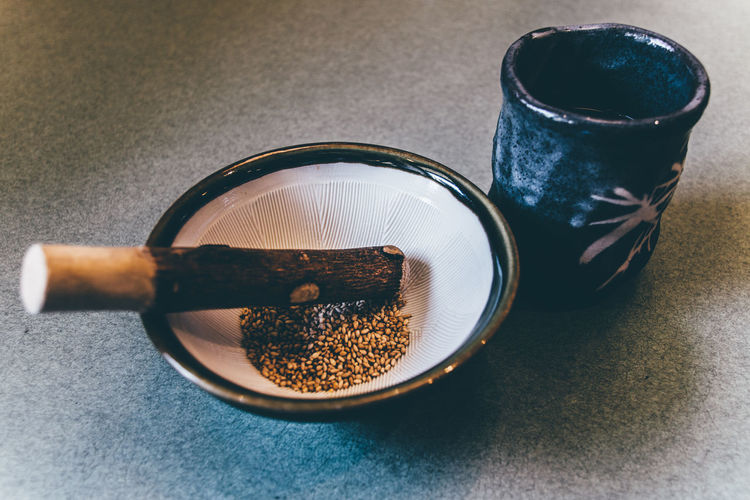 Close-Up Of Spices In Mortar And Pestle On Table