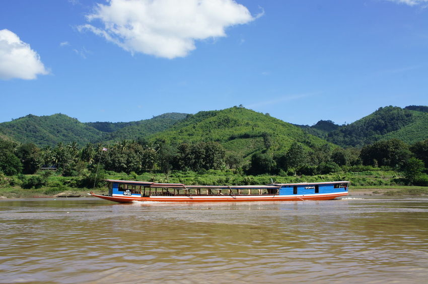 Beauty In Nature Day Forest Lake Mekong Mekong River Mountain Nature Nautical Vessel No People Outdoors Pedal Boat River Cruise River View Riverscape Riverside Scenics Sky Sunlight Tree Water