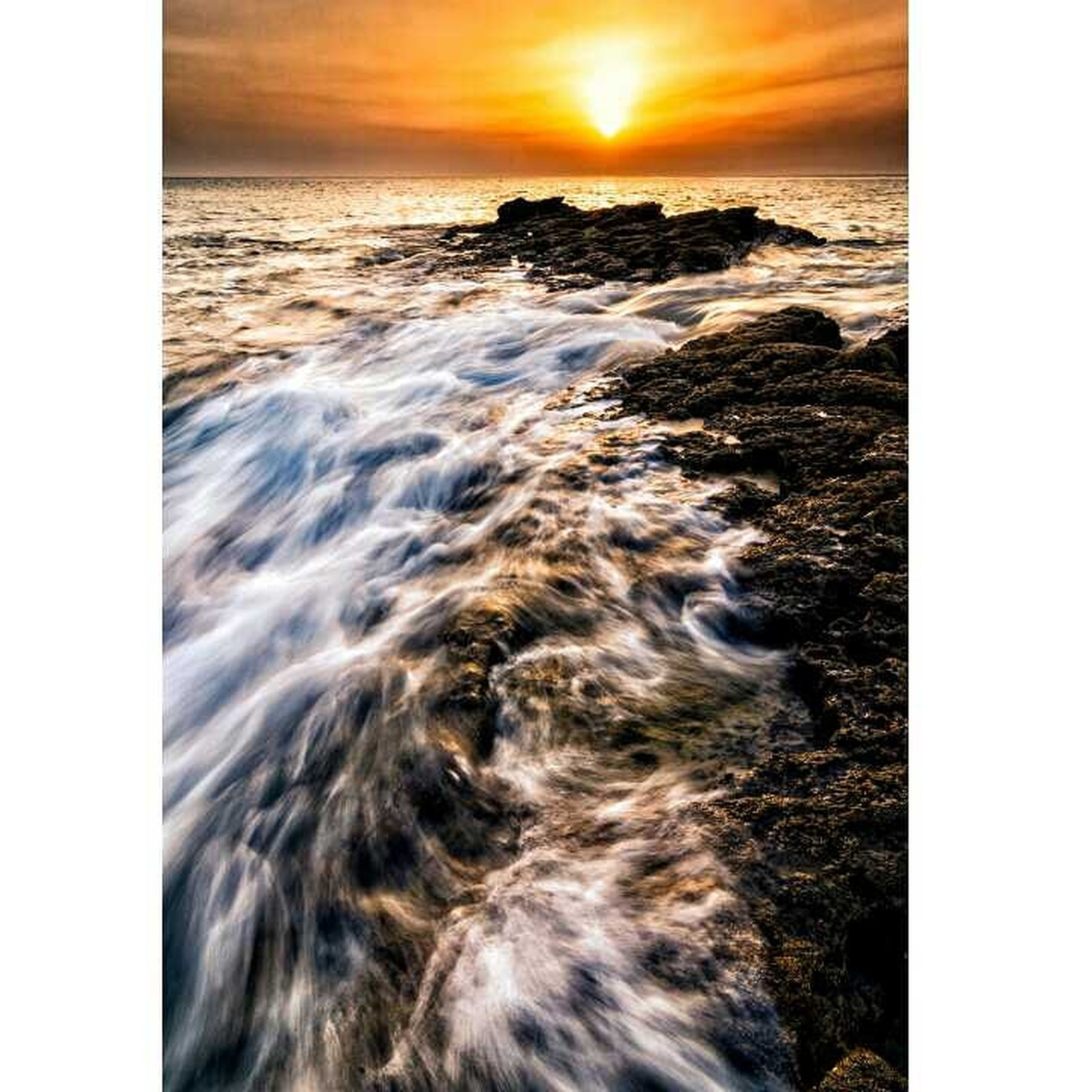 sea, water, motion, sky, sunset, beach, nature, land, scenics - nature, wave, rock, beauty in nature, rock - object, auto post production filter, sport, horizon over water, cloud - sky, horizon, solid, no people, outdoors, sun, power in nature