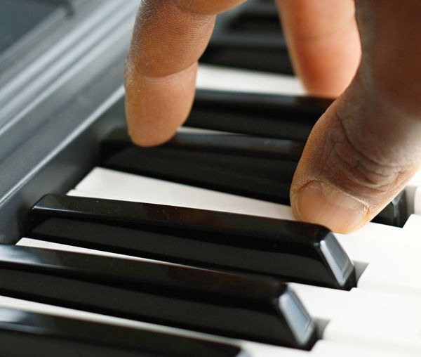 piano player performing in a concert Grand Piano Hard Home Image Bass Close-up Concert Cord Finger Fingernail High Notes Human Body Part Human Finger Human Hand Indoors  Music Musical Instrument One Person Organ People Performing Arts Event Piano Playing Playing Music Real People