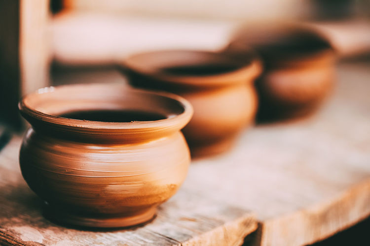 Close-up of bowls on wooden table