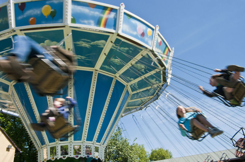 Low angle view of children enjoying in chain swing ride