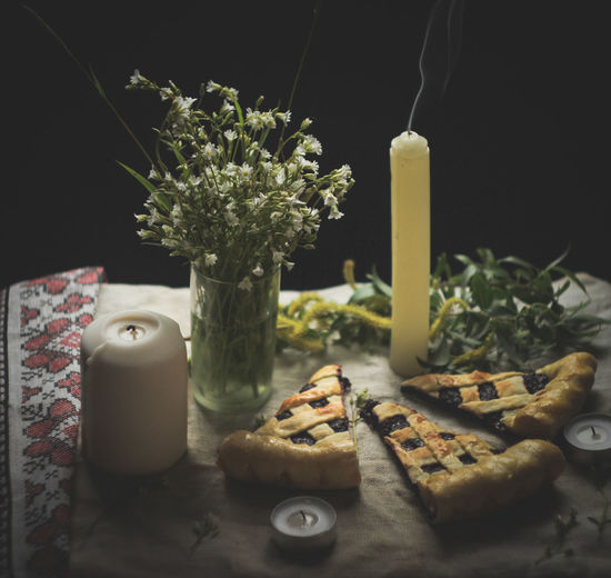 Still life. Pie. Currant pie. Spring still life. Food And Drink Food Table Indoors  Freshness Candle No People Still Life Container Cutting Board Indulgence Close-up Wellbeing Flower Bottle Burning Decoration Baked Nature Flowering Plant Temptation Black Background Candle