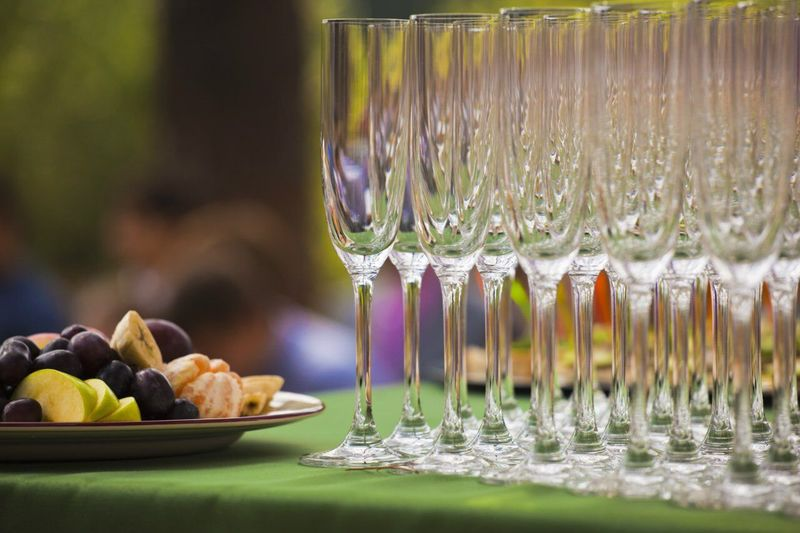 Fruit salad with champagne flutes arranged on table