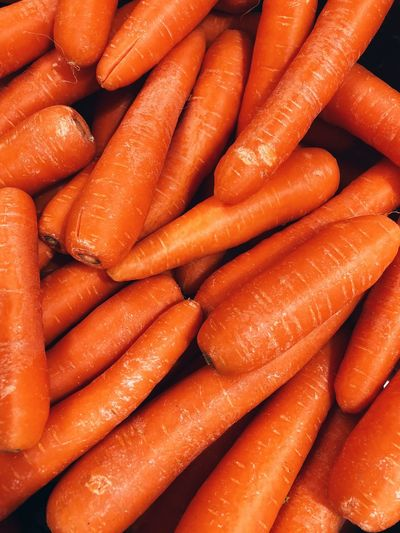 Carrots Carrot Food And Drink Root Vegetable Food Healthy Eating Freshness Vegetable Raw Food Market Still Life Abundance Backgrounds Close-up No People Large Group Of Objects Full Frame For Sale Orange Color Organic Wellbeing