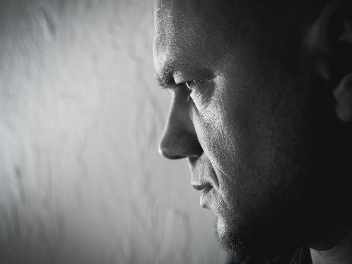 Close-Up Of Thoughtful Mature Man Looking Away