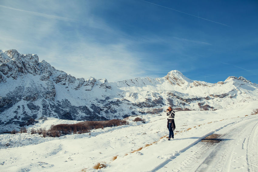 man travel in mountains covered with snow. Winter travel Camera EyeEm Best Shots Man Snow ❄ Taking Photos Tourist Travel Winter Wintertime Awesome Beauty In Nature Cold Cold Temperature Landcape Male Mountain Mountains Nature One Person Outdoors Photographer Picturesque Real People Scenics Snow
