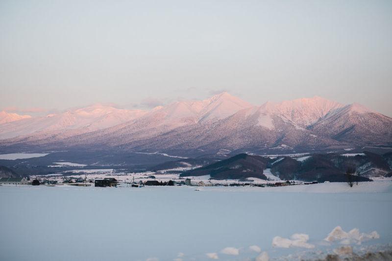 Furano Japan Beauty In Nature Cloud - Sky Cold Temperature Environment Mountain Mountain Peak Mountain Range Purple Sky Scenics - Nature Snow Snowcapped Mountain Sunset Tranquil Scene