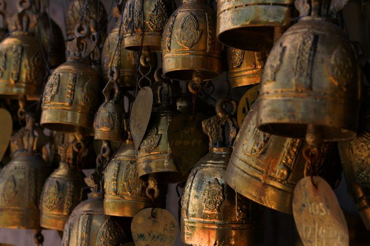 Full frame shot of bells on a wall