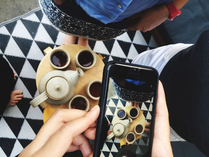 Social Media Social Media Addicts Black And White Pattern Tea Time Phone Human Hand Real People Hand Human Body Part One Person Holding Lifestyles Leisure Activity High Angle View Coffee Food And Drink Personal Perspective Directly Above