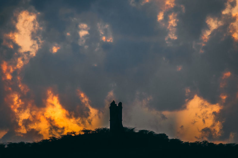 Sky Cloud - Sky Built Structure Architecture Sunset Building Exterior Nature No People Silhouette Beauty In Nature Tower Building Outdoors Scenics - Nature Plant Orange Color Low Angle View History Guidance