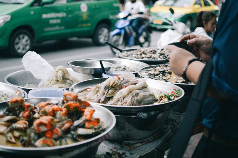 street food Food And Drink Food Real People Incidental People Freshness One Person Hand Mode Of Transportation Human Hand Business Day Seafood Background